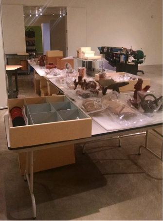 All the objects are staged in a convenient location prior to arranging them in the exhibition.